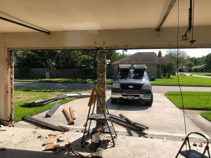 3.removing the old frame and garage door