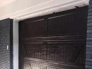 brown wooden garage door installation