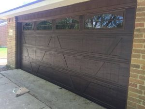 brown wooden garage door with windows