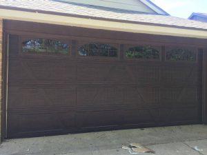 two car wooden garage door with windows