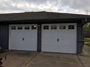 two-white-carrige_style_garage_door_with_windows (3)