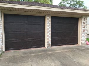 two wooden garage doors (2)