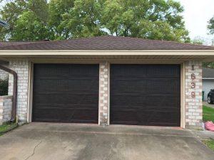 two wooden garage doors
