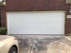white aluminum garage door installation