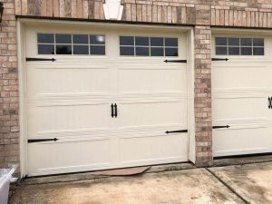 white carrige style two garage door with windows (2)