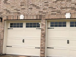 white carrige style two garage door with windows (3)