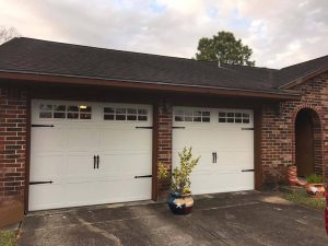 white carrige style two garage doors