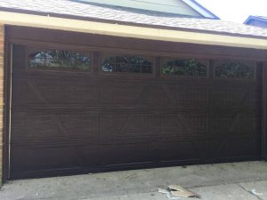 wooden two car garage door with windows